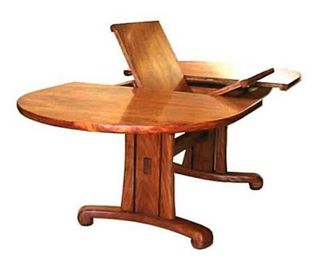 A Contemporary Hand Made Koa Wood Dining Table Featuring Butterfly Leaf